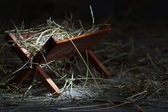 Krubba i det stabila abstrakta julsymbolet royaltyfri bild