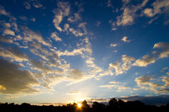 Kruger sunset. A stunning sunset photo with fluffy white clouds and a blue sky Royalty Free Stock Image