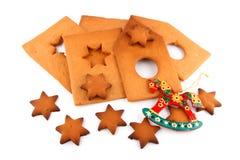 Kruid-cake huis, zoete sterren en rood paard Royalty-vrije Stock Afbeeldingen