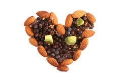 Kruiden en noten in hartvorm Stock Foto