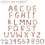 Kruidig die Alfabet met brief door droge Thaise kruidige Spaanse peperpeper wordt gespeld Stock Foto