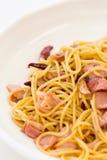 Kruidige en baconspaghetti Stock Afbeeldingen
