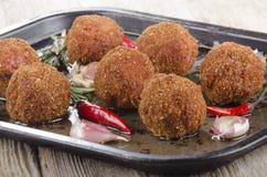 Kruidige vleesballen met rozemarijn en Spaanse peper stock afbeelding