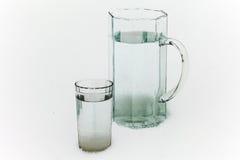 Kruik en glas water Royalty-vrije Stock Afbeeldingen