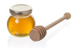 Kruik honing met dipper Stock Afbeelding