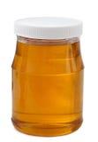 Kruik honing met houten stok royalty-vrije stock fotografie