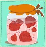 Kruik met jam en aardbeien daarin Stock Afbeeldingen
