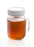 Kruik met ruwe honing stock foto's