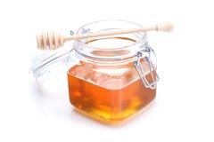 Kruik van honing en dipper Royalty-vrije Stock Afbeelding