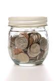 Kruik van muntstukken stock foto