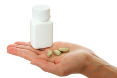Kruik van vitaminen in de palm. Stock Afbeeldingen