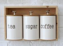 Kruik voor thee, suiker, de reeks van de koffiedoos Stock Foto's