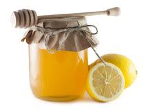 Kruiken met honing en citroen Stock Fotografie
