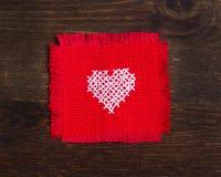 Kruis gestikt hart Stock Fotografie