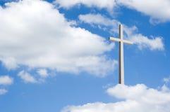 Kruis op wolken Stock Foto