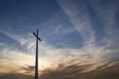 Kruis in zonsondergang Royalty-vrije Stock Foto's