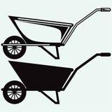 Kruiwagen in tuin Royalty-vrije Stock Afbeeldingen