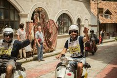 Kruje, Albania - June 2018: Vespa legend team on a trip in Albania riding though old town during tour in Albania.  royalty free stock photography