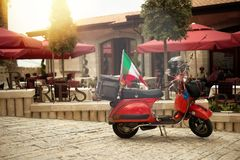 Kruje, Albania - June 2018: Vespa legend team on a trip in Albania riding though old town during tour in Albania.  royalty free stock photo