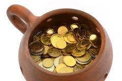 Kruka av pengar Arkivbilder
