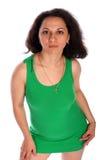 Krullend-geleid meisje in groene hoge mening Stock Afbeelding