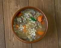 Krupnik. Thick Polish soup made from vegetable or meat broth, containing potatoes and barley groats Stock Photo