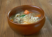 Krupnik. Thick Polish soup made from vegetable or meat broth, containing potatoes and barley groats Stock Photography