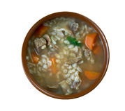 Krupnik. Thick Polish soup made from vegetable or meat broth, containing potatoes and barley groats Stock Image