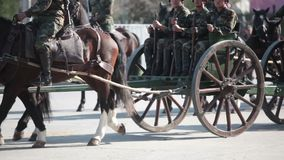 Krupp Gun in a Parade. Santiago, Chile - September 15, 2011: Soldiers marching with an ancient piece of artillery `Krupp gun` in a rehearsal of the Great