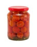 Krus för exponeringsglas för ekologiska tomatgrönsaker på burka Royaltyfria Bilder