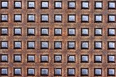 Kruszcowe tekstury na ściekowym manhole Obraz Stock