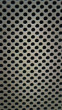 Kruszcowy talerz przebijający w dziury tekstury tle Fotografia Royalty Free