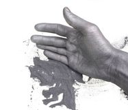 Krut och hand Arkivbilder