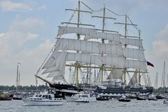 The Kruzenshtern tall ship on the Ij river. Ij River, Amsterdam, the Netherlands - August 19, 2015: The Kruzenshtern tall ship (Russia) on the Ij river Royalty Free Stock Image