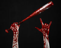 Krwista ręka trzyma kij bejsbolowego, krwisty kij bejsbolowy, nietoperz, krwionośny sport, zabójca, żywi trupy, Halloween temat,  obraz stock