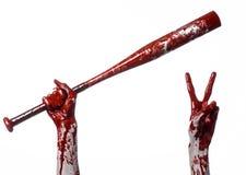 Krwista ręka trzyma kij bejsbolowego, krwisty kij bejsbolowy, nietoperz, krwionośny sport, zabójca, żywi trupy, Halloween temat,  Zdjęcia Stock