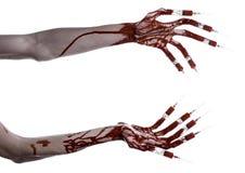 Krwista ręka z strzykawką na palcach, palec u nogi strzykawki, ręka opryskuje, okropna krwista ręka, Halloween temat, żywy trup l Obraz Royalty Free