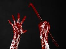 Krwiste ręki z piętakiem, ręka haczyk, Halloween temat, zabójców żywi trupy, czarny tło, odizolowywający, krwisty piętak, Zdjęcie Stock