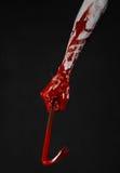 Krwiste ręki z piętakiem, ręka haczyk, Halloween temat, zabójców żywi trupy, czarny tło, odizolowywający, krwisty piętak, Obraz Stock