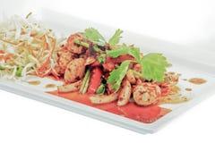 Kryddig fiskboll med grönsaker Arkivbilder