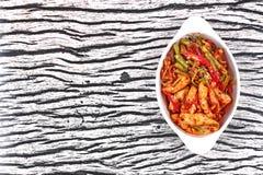 Kryddig stekt cowpea och tioarmad bläckfisk med grillad chiledeg Royaltyfri Fotografi