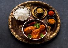 Kryddiga ben för feg curry med ris Royaltyfria Bilder