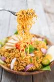 Kryddiga stekte ögonblickliga nudlar för curry Fotografering för Bildbyråer