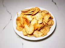 Kryddigt potatisrån royaltyfri bild