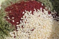Kryddor av za` atar, sumac- och sesamfrö Fotografering för Bildbyråer