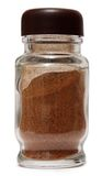 Kryddor. Glass krus med peppar som isoleras på vit Royaltyfri Fotografi