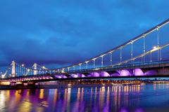 Krymsky Bridge or Crimean Bridge across the Moskva river in Moscow in the rays of setting sun in the evening blue hour. With illumination stock images
