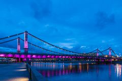 Krymsky Bridge or Crimean Bridge across the Moskva river in Moscow in the rays of setting sun in the evening blue hour. With illumination royalty free stock photos