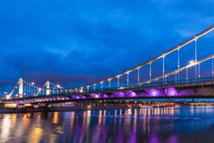 Krymsky Bridge or Crimean Bridge across the Moskva river in Moscow in the rays of setting sun in the evening blue hour. With illumination stock image