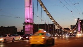 Krymsky Bridge or Crimean Bridge and traffic of cars (night)-- is a steel suspension bridge in Moscow, Russia stock footage